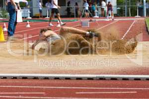 landing in the sand at the long jump