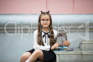 Schoolgirl with plush toy