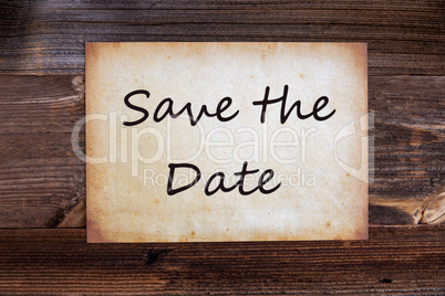 Old Paper, Text Save The Date, Wooden Background