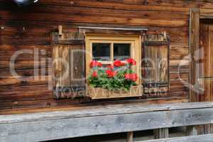 Windows with shutters in a wooden house