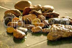 pebbles stones in rain on a desk