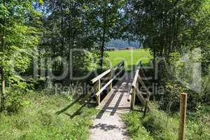 Wooden bridge over a small mountain river
