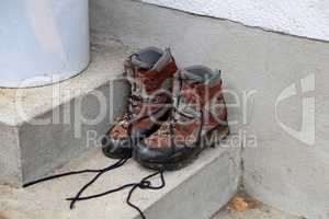 Dirty shoes stand on the porch of the house
