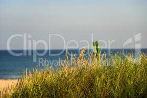 Baltic Sea in Poland, beach with beach grass and table