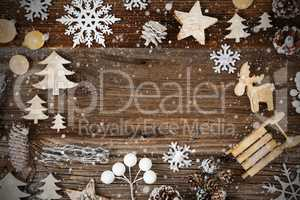 Wooden Background. Frame Of Christmas Decoration Like Sled And Snowflakes