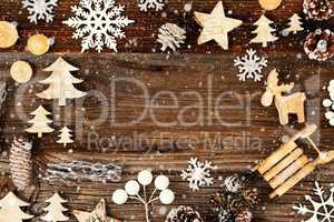 Frame Of Christmas Decoration Like Tree And Snowflakes. Wooden Background