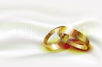 Two wedding rings on silk background