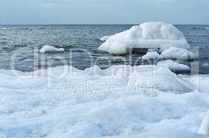 the sea is frozen, pierce in the ice, the sea coast in the ice winter on the Baltic sea, icing on the seafront