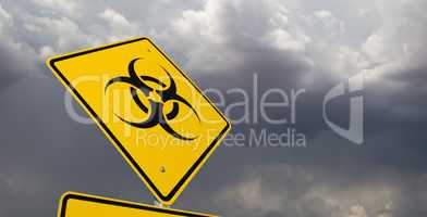 Bio-hazard Yellow Road Sign Against Ominous Stormy Cloudy Sky