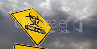 Bio-hazard Symbol With SARS-CoV-2 Coronaravirus Yellow Road Sign