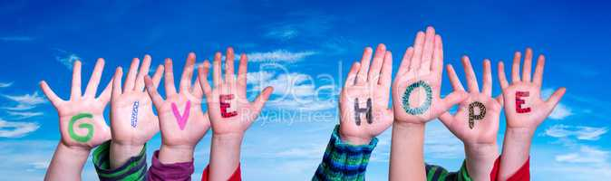 Children Hands Building Word Give Hope, Blue Sky