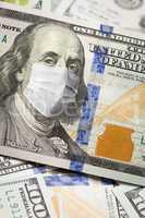 One Hundred Dollar Bill With Medical Face Mask on Face of Benjam