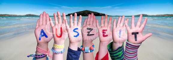 Children Hands Building Word Auszeit Means Downtime, Ocean Background
