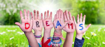 Kids Hands Holding Word Dreams, Grass Meadow