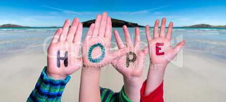 Children Hands Building Word Hope, Ocean Background