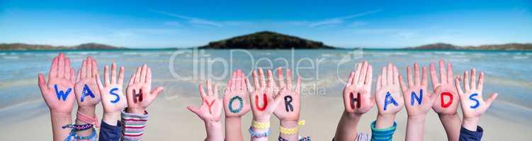 Kids Hands Holding Word Wash Your Hands, Ocean Background