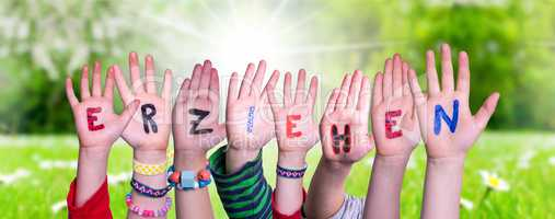 Children Hands Building Word Erziehen Means Educate, Grass Meadow