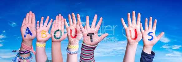 Children Hands Building Word About Us, Blue Sky