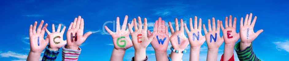 Children Hands Building Word Ich Gewinne Means I Am Winning, Blue Sky