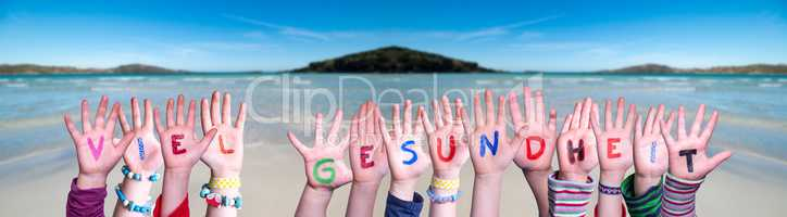 Kids Hands Holding Word Viel Gesundheit Means Stay Healthy, Ocean Background