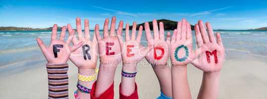 Children Hands Building Word Freedom, Ocean Background