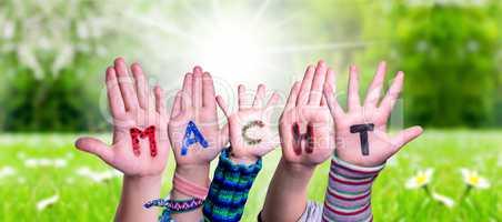Children Hands Building Word Macht Means Power, Grass Meadow