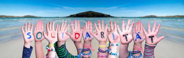 Kids Hands Holding Word Solidaritaet Means Solidarity, Ocean Background