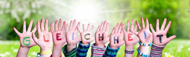 Children Hands Building Word Gleichheit Means Equality, Grass Meadow