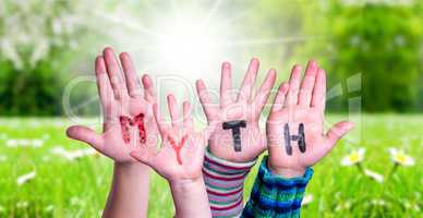 Kids Hands Holding Word Myth, Grass Meadow