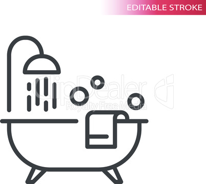 Bathtub with shower, towel and bubbles