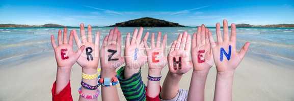 Children Hands Building Word Erziehen Means Educate, Ocean Background