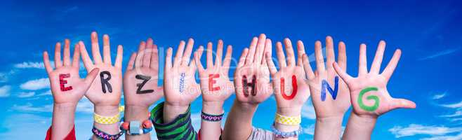 Children Hands Building Word Erziehung Means Education, Blue Sky