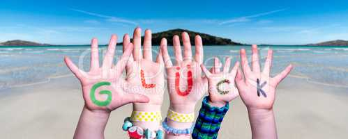 Children Hands Building Word Glueck Means Luck, Ocean Background
