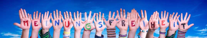 Children Hands Building Word Meinungsfreiheit Means Freedom Of Opinion, Blue Sky
