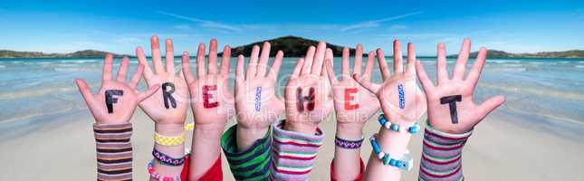 Children Hands Building Word Freiheit Means Freedom, Ocean Background