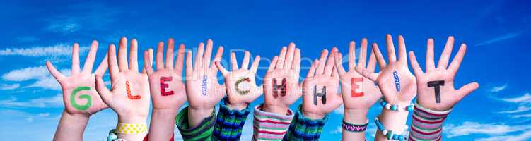 Children Hands Building Word Gleichheit Means Equality, Blue Sky