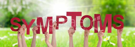 People Hands Holding Word Symptoms, Grass Meadow