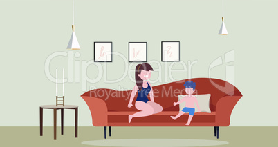 woman sitting with her son in a room