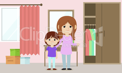 mother dressing up her daughter at home