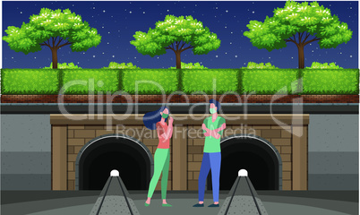 couple standing near railway track and talking to each other