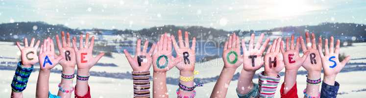 Children Hands Building Word Care For Others, Snowy Winter Background