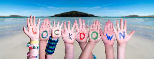 Kids Hands Holding Word Lockdown, Ocean Background