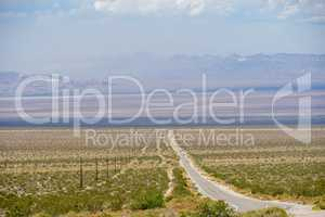 Endless desert road. Adventure travel in a desert.