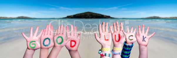 Kids Hands Holding Word Good Luck, Ocean Background