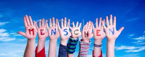 Children Hands Building Word Menschen Means Human, Blue Sky