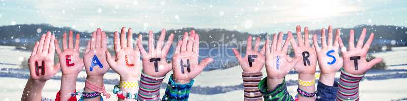 Children Hands Building Word Health First, Snowy Winter Background