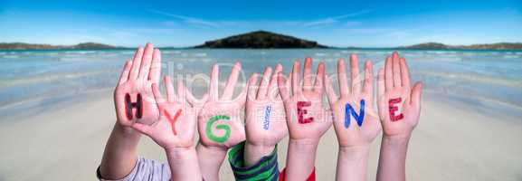 Kids Hands Holding Word Hygiene, Ocean Background