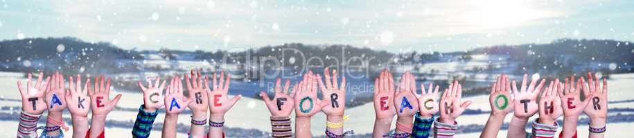 Children Hands Building Word Take Care For Each Other, Snowy Winter Background