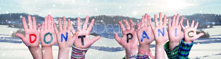 Kids Hands Holding Word Do Not Panic, Snowy Winter Background