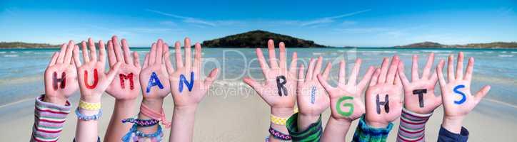 Children Hands Building Word Human Rights, Ocean Background